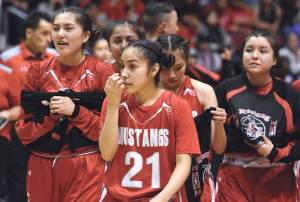 Navajo Times | Donovan Quintero Monument Valley Lady Mustang Kaitlyn Johnson (21) and her teammates get ready to congratulate the Page Lady Sand Devils for winning the Arizona 3A girls championship title Monday in Glendale, Ariz.