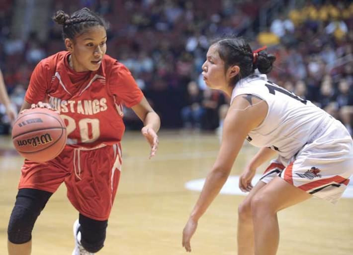 Navajo Times | Donovan Quintero Monument Valley's Jazlyn Lane (20) looks for a way around closely guarding Lady Sand Devil Mikala Benally Monday in Glendale, Ariz.