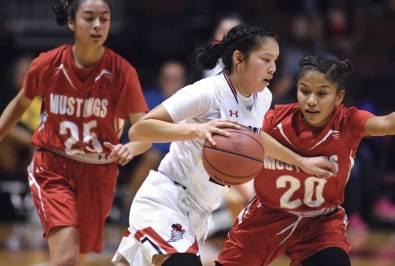 Navajo Times | Donovan Quintero Page Lady Sand Devil Myka Taliman drives by guarding Lady Mustang Jazlyn Lane (20) on Monday.