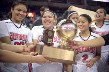 Navajo Times | Donovan Quintero St. Michael Lady Cardinals Delilah Nakaidinae, left, Sherilynn Herrera, center, and Chrissa Duncan (2) and their teammates celebrate with the Arizona 1A girls' championship trophy after defeating the Baboquivari Lady Warriors, 60-44, on Saturday at the Prescott Valley Events Center in Prescott Valley, Ariz.