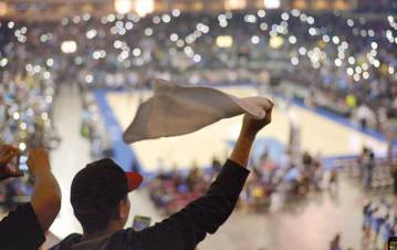 Navajo Times | Donovan Quintero A cheering Alchesay Falcons fan swings a towel Saturday during the Arizona 2A boys championship game against the Rancho Solano Prep Mustangs at the Prescott Valley Events Center in Prescott Valley, Ariz.