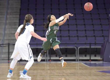 Navajo Times | Donovan Quintero Flagstaff Lady Eagle Monique Ware passes the ball away from a guarding Pueblo Magnet Lady Warrior Friday in Phoenix.