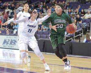 Navajo Times | Donovan Quintero Flagstaff Lady Eagle Reece Honanie (5) drives the ball against a Pueblo Magnet Lady Warrior defender Monday at the Grand Canyon University gymnasium in Phoenix.