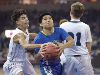 Navajo Times | Donovan Quintero Apache Skylar Kindelay, center, gets past a pair Gregory School defenders on Saturday during the Arizona 1A boys championship game at the Prescott Valley Events Center in Prescott Valley, Ariz.