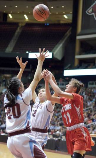Navajo Times | Donovan Quintero Monument Valley Lady Mustang Briana Gillis (11) Ganado's Amber James (20) and Jayla Mcintosh (12) go after the ball Friday at the Gila River Arena in Glendale, Ariz.
