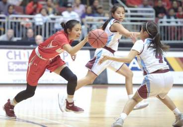 Navajo Times | Donovan Quintero Monument Valley Lady Mustang Sheridan Gray, left, takes the ball to Ganado's Deana Curley (4) Friday in Glendale, Ariz.