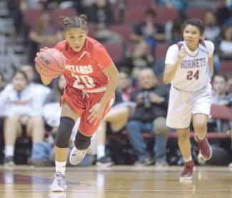 Navajo Times | Donovan Quintero Monument Valley's Jazlyn Lane (20) runs the ball down the court as Ganado Lady Hornet Jamika Coleman (24) looks on during the Arizona 3A girls semifinals in Glendale, Ariz.