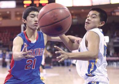 Navajo Times | Donovan Quintero Red Mesa's Hunter Pipkin (21) and a Fort Thomas Apache player watch the ball go out of bounds Friday in Prescott Valley, Ariz.