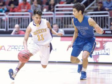 Navajo Times | Donovan Quintero Blue Ridge's Corey Endfield (11) drives against a Valley Christian Trojan defender on Saturday at the Gila River Arena in Glendale, Ariz.