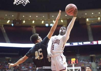 Navajo Times | Donovan Quintero Winslow's Yoann Djassa (5) takes the ball by guarding Chinle Wildcat Elijah James (45) for the basket Friday in Glendale, Ariz.