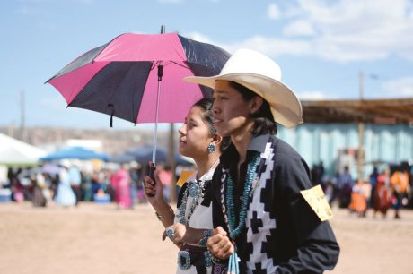 Navajo Times | Ravonelle Yazzie A duo of young song and dancers bear the heat on Saturday at the song and dance event during the Navajo Nation Fair.
