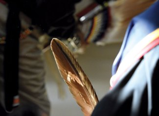Navajo Times | Donovan Quintero A gourd dancer holds a feather during the Veterans Day Gourd Dance in Fort Defiance.