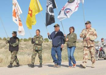 Special to the Times | Colleen Keane TóHajiilee veterans raise the Navajo Nation, New Mexico, U.S. and POW/MIA flags as they lead the 4th annual TóHajiilee Veteran's parade on Nov. 10.