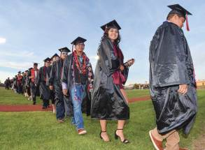 Special to the Times | Krista Allen Eleanor George beams with joy as she walks with her classmates during Page High's graduation at Cyclone Stadium on May 18.