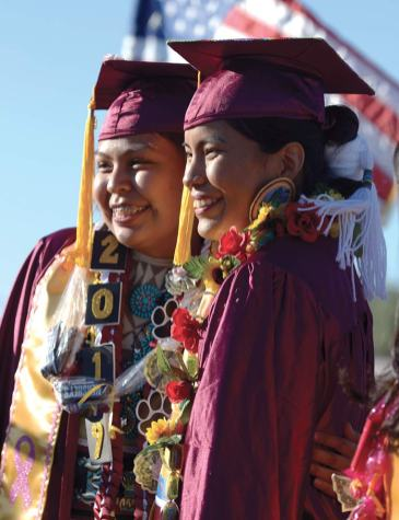 Navajo Times | Donovan Quintero Rock Point High graduates and classmates Chrystalana Clark, right, and Ranisha Begay, are shown on Saturday during their graduation in Rock Point, Ariz.
