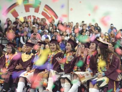 "Navajo Times | Donovan Quintero To'Hajiilee High graduates cheer during their graduation on Saturday morning in To""Hajiilee, N.M."