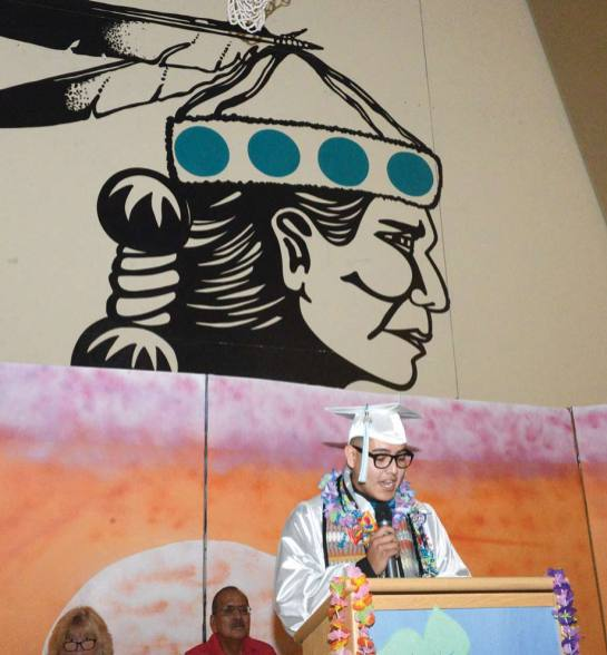 Navajo Times | Pfaul Nfatonabah Senior Emmitt Castillo gives his salutatorian address Tse Yi Gai High's graduation on Saturday, May 18. Twenty-one seniors graduated.