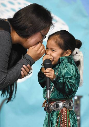 Navajo Times   Ravonelle Yazzie Four-year-old Nanu Thompson gets shy onstage during the baby contest at the Navajo Nation Fair on Wednesday in Window Rock.
