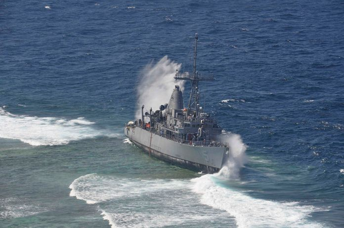 1200px uss guardian being struck by a wave while aground - naval post- naval news and information