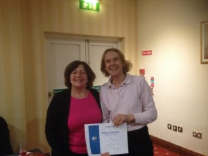 Anne McFarland receiving first prize in the Club International Speech contest from Navan Toastmasters President Catherine Reilly.