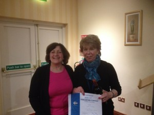 Sheila Dennehy receiving first prize in the Club International Evaluation contest from Navan Toastmasters President Catherine Reilly.