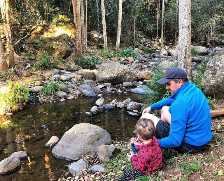 Thunderbird Park creek - Dad and Son sitting on the creek bed