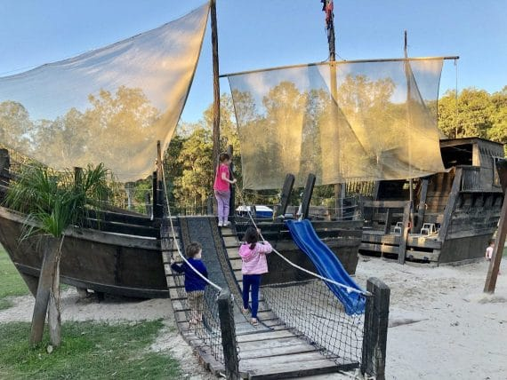 Children playing on pirate ship at Cobb and Co Nine Mile