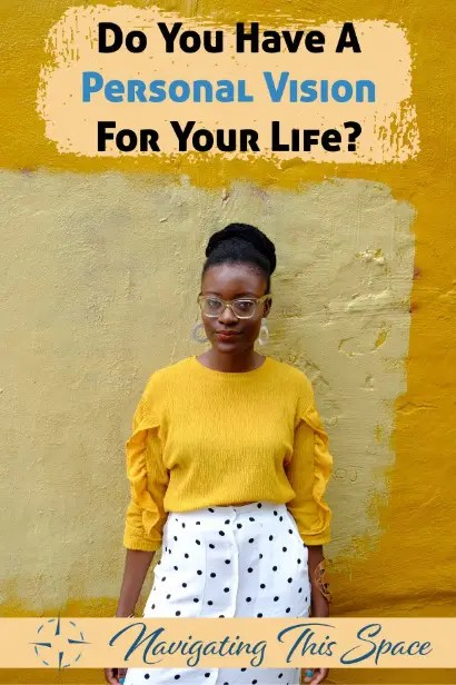 Woman wearing yellow shirt poses for the camera while visioning her life
