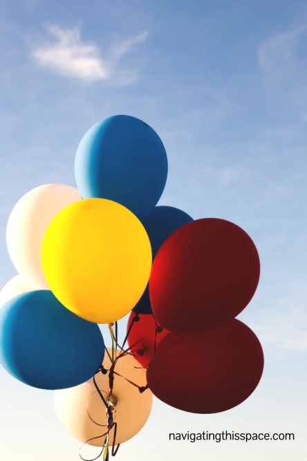 red, yellow, blue, and white balloons in the sky