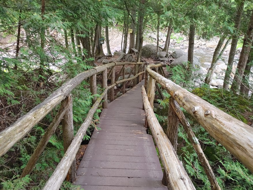 Natural stone bridge and caves, wooden walkway