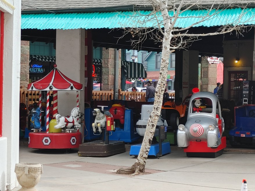 the kiddie rides outside of the Penny Arcade, Colorado Springs with kids