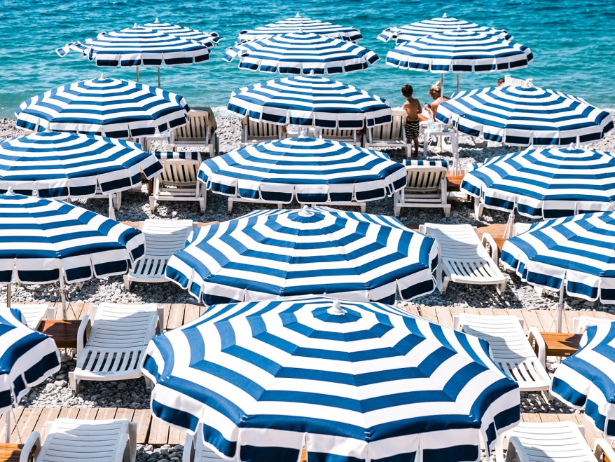 Nice beach umbrellas, family friendly cities in France