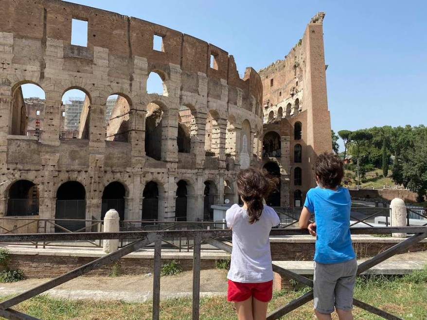 kids standing by the colosseum in Rome