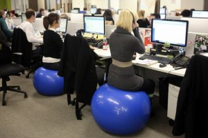 office workers on exercise balls instead of chairs