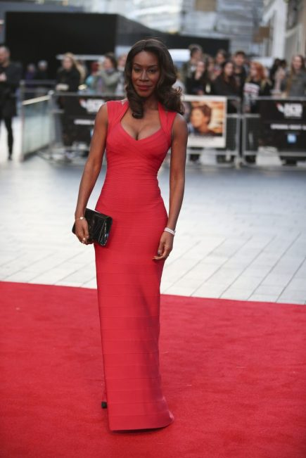 """British screenwriter and director Amma Asante poses on the red carpet for the film """"A United Kingdom"""" during the opening night gala event for the BFI London Film Festival in London on October 5, 2016. / AFP PHOTO / DANIEL LEAL-OLIVAS"""
