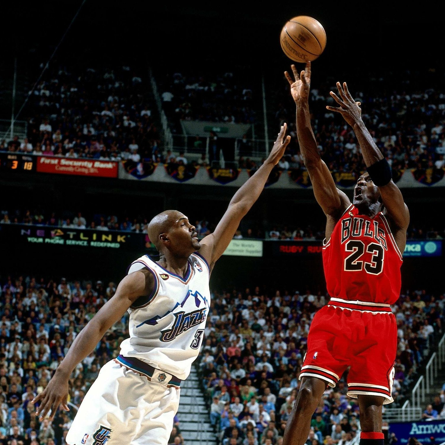 hi-res-75293719-michael-jordan-of-the-chicago-bulls-shoots-a-jump-shot_crop_exact