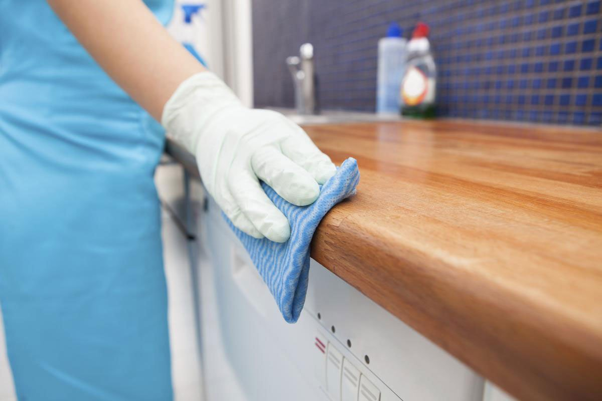 Maid Wipes Down Kitchen Counter