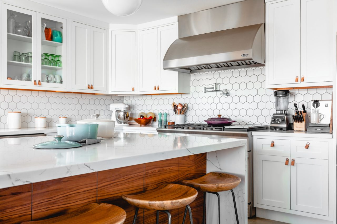 A sparkling clean kitchen with a white color scheme.