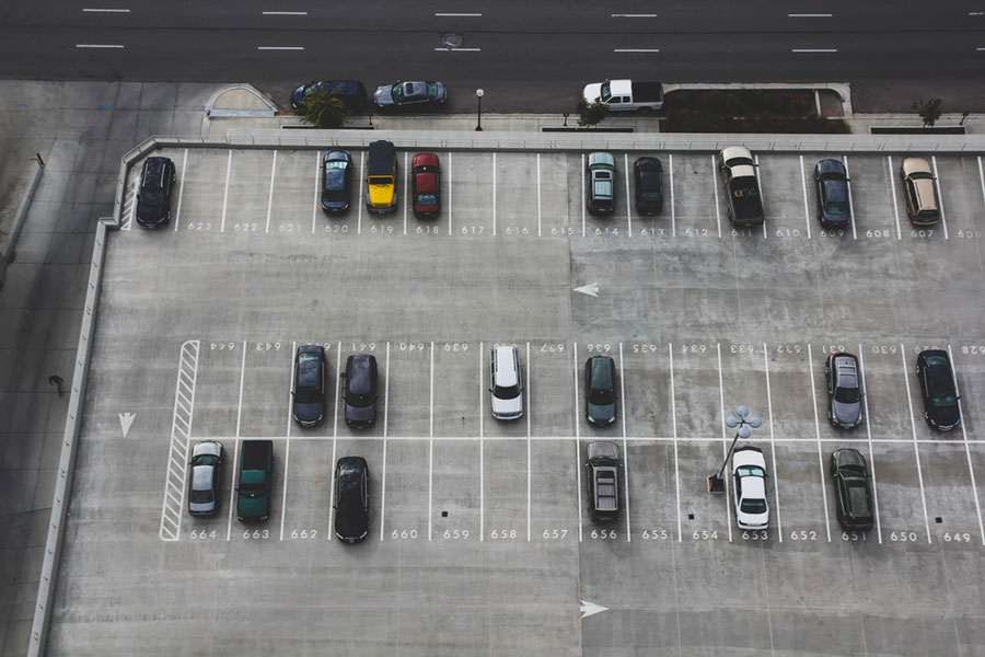 An aerial view of a large, well-striped, and numbered parking lot.
