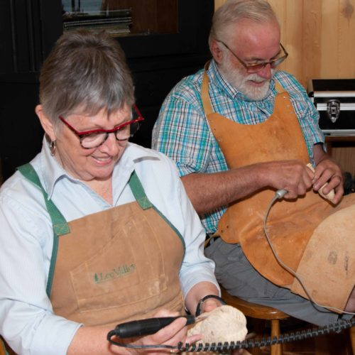 Walter and Alma carving together
