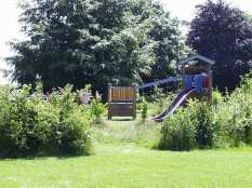 School- multi-function play unit with new hedge planting around