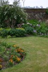 One of the front borders which is showing a great variety of foliage and some colourful flowers at present