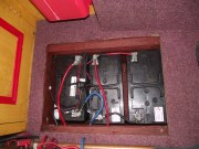 Battery compartment - Black charging cables appearing from top of picture positives connected through fuse holders (small red wire)