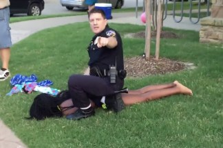 Cpl. David Eric Casebolt restraining a 15-year-old girl outside a community pool in McKinney, Texas.