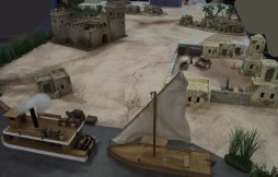 The captured river steamer and supplies are in the foreground. The captives are in the fort.