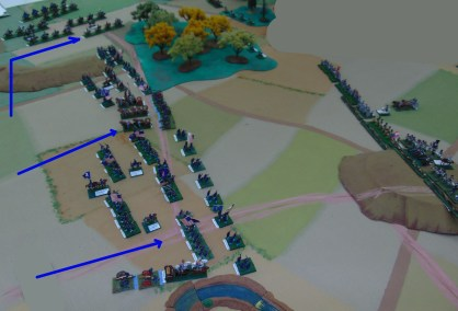 The Union advance with most of the artillery in the center, infantry brigades on each side and cavalry on the far left.