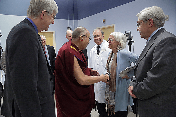 Dr. Briggs meets with the Dalai Lama, escorted by Dr. Collins.