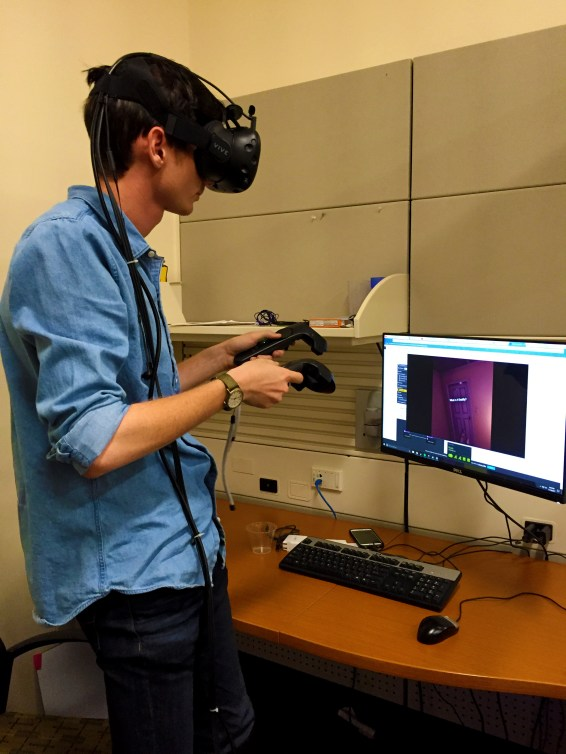 "Hunter Osking experiencing the digitalized reality of his work-in-progress game ""Flowers for Dan Dan"" using the HTC Vive."
