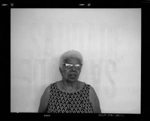 Grandmother against a plain wall