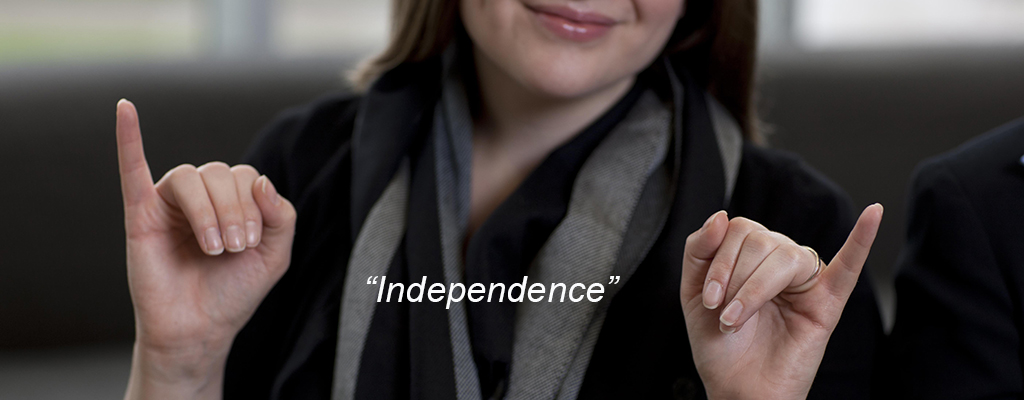 "A person signs ""Independence"" in American Sign Language"